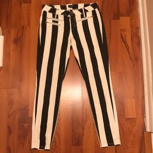 Bebe black and white stripped jeans